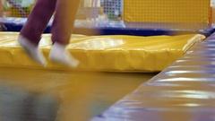 Kid is jumping on trampoline Stock Footage