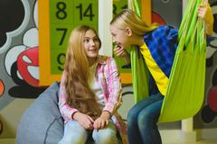 Group of happy kids playing in children room Kuvituskuvat