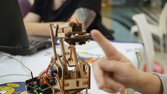 Small toy robotics robot arm in action Stock Footage