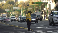 Mexico City street scene with two traffic cop. Overpopulated city Stock Footage