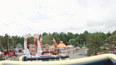 Happy Kids Riding Roller Coaster Stock Footage