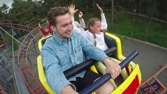 Joyous Ride on Roller Coaster Stock Footage