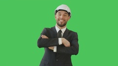 Handsome Smiling Businessman in a Tailored Suit with a Hard Hat  Stock Footage