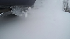Car tire on the winter road Stock Footage