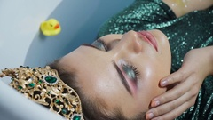 Close-up of a wet woman with bright makeup breathing heavily Stock Footage
