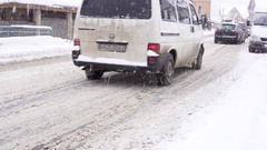 Bukovel, Ukraine on December 28th: Traffic on the road in Bukovel, Ukraine Stock Footage