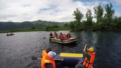 Group of tourists and travelers floating on calm river on raft Stock Footage