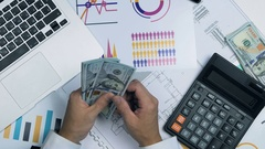 Male Hands Count profit, hundred Dollar Bills. Close Up. Above view Stock Footage