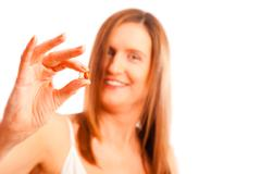 Anti-ageing Concept: Woman In Her Forties With Youth-pills Stock Photos