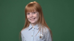 Cute ginger girl with freckles shirt smiling Stock Footage