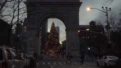 Washington Square Park arch with Christmas tree and Freedom Tower at dusk NYC Stock Footage