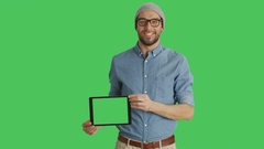 Mid Shot of a Smiling Young Man Wearing Glasses Presenting Tablet Computer  Stock Footage