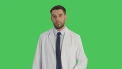 Medium Shot of a Handsome Medical Practitioner Crossing Arms on His Chest Stock Footage