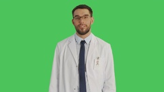Mid Shot of a Doctor/Scientist Wearing Glasses Making I have an Idea Gesture.  Stock Footage