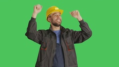 Mid Shot of a Worker Wearing Hard Hat Dancing and Raising His Hands.  Stock Footage