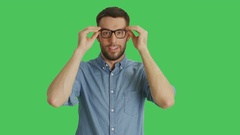 Mid Shot of a Handsome Smiling Adult Man Correcting His Glasses.  Stock Footage