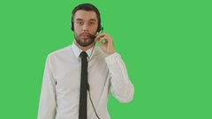 Medium Shot if a Handsome Man Wearing Shirt and Tie Talking on a Headset.  Stock Footage