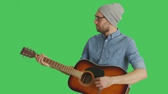 Mid Shot of a Young Talented Musician Wearing Hat and Glasses  Playing Guitar Stock Footage