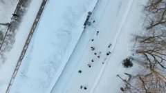 People on a snow road from a bird's eye view Stock Footage
