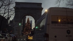 Green traffic light at Washington Square Park arch with Christmas tree night NYC Stock Footage