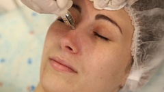 Cosmetologist doing facial massage Stock Footage
