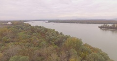 Panoramic aerial forest and Riverside of Danube autumn day, Europe main river Stock Footage