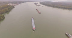 Riverside of the Danube in autumn. Transport ships sailing the river. Stock Footage
