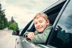 Happy boy travel with father in auto Stock Photos