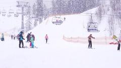 Bukovel, Ukraine on December 28th: People At Ski Resort In Bukovel at Ski lift Stock Footage