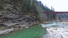 Beautiful landscape with river and bridge in Carpathians Stock Footage