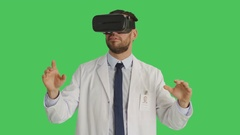 Mid Shot of a Scientist Wearing VR Headset in Wonderment Gesticulating Stock Footage