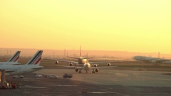 Airport runway at sunset. Plane take off - Char de gaulle, Paris Stock Footage