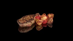 Steak with baked potatoes and fresh tomatoes. Stock Footage