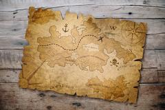 Treasure map on wooden table Stock Photos