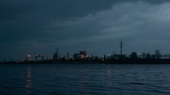 Night landscape with city lights, transmission towers, power station Stock Footage