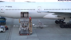 Docked plane in the airport service area - Char de gaulle, Paris Stock Footage