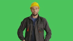 Mid Shot of a Handsome Worker Wearing Hard Hat Crossing His Arms and Smiling.  Stock Footage