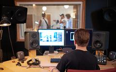 Music band during cd recording in studio Stock Photos