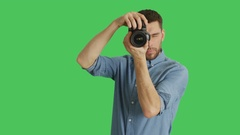 Mid Shot of a Handsome Photographer Taking Pictures. Background is Green Screen. Stock Footage