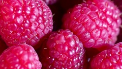 Juicy fresh raspberries rotating. Raspberries fruit background. Macro shot. Stock Footage