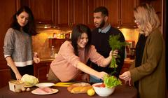 Group of multi ethnic young friends in kitchen prepare for party Stock Photos