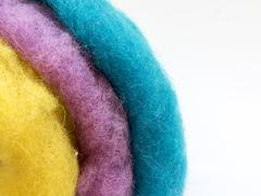 Unusual background about the handmade, with colored wool and place for text Stock Photos