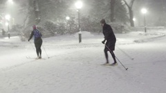 Snowy Cross Country Skiiers in Central Park Stock Footage