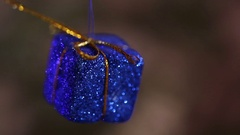 Glittering Christmas package in the background flashing lights Stock Footage