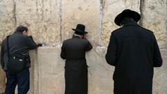 Jews praying in front of Western wall in the old city of the Jerusalem, Israel.  Stock Footage