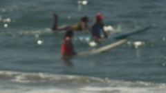 Surfers surfing in a group at a crowed line-up, slow motion. Stock Footage