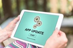 Application update concept on a tablet Stock Photos