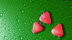 Strawberries on green table with water drops Stock Footage