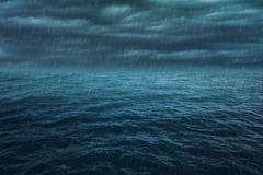 Rain over the stormy sea, abstract dark background Kuvituskuvat