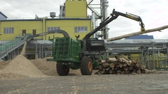 Woodchipper at the factory chipping large piece of wood. Stock Footage